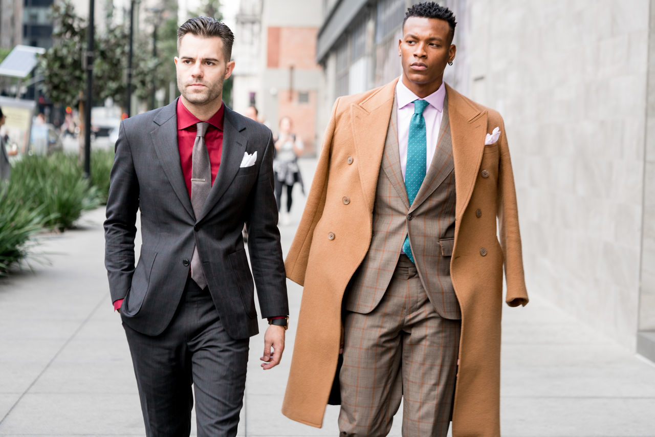 businessman, two people, well-dressed, suit, young adult, business, men, young men, full suit, front view, professional occupation, corporate business, standing, friendship, business person, togetherness, occupation, formalwear, day, outdoors, portrait, adult, teamwork, young women, adults only, only men, people