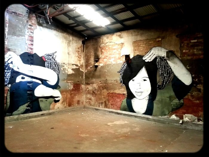 Be Free Streetart in an Abandoned Places old butchers shop Stencil