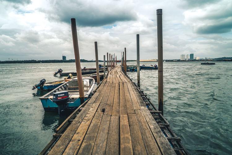 Lim Chu Kang Jetty, Singapore. Cloud - Sky Fishing Boat Fishing Village Jetty Old Pier Rustic Sea Singapore Water