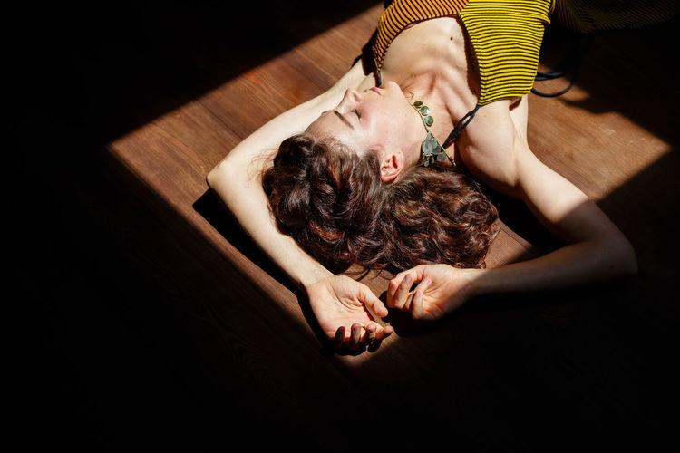 High angle view of woman sleeping on floor