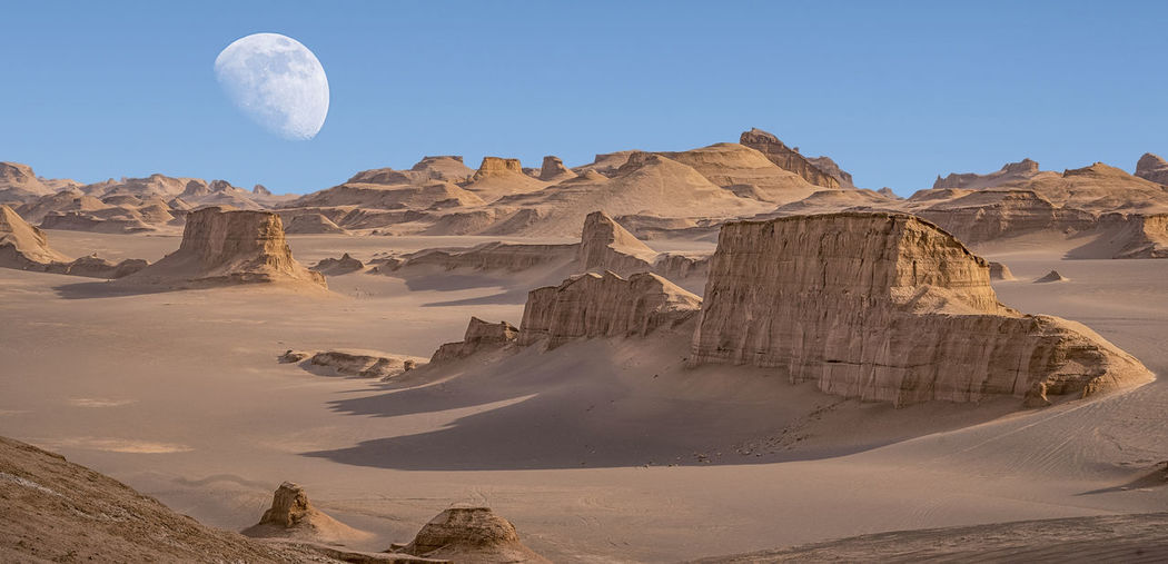 Panoramic view of rock formations in desert against sky