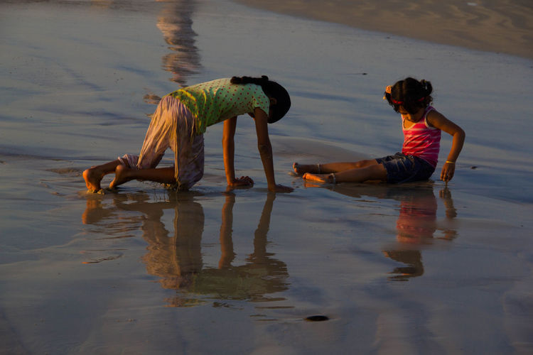 Children playing on the beach Balance Beach Children Playing Coastline Enjoyment Leisure Activity Ocean Outdoors Real People Recreational Pursuit Sand Sea Shore Summer Tourist Vacations Water Wave Weekend Activities Youth Of Today Color Of Life! Color Of Life