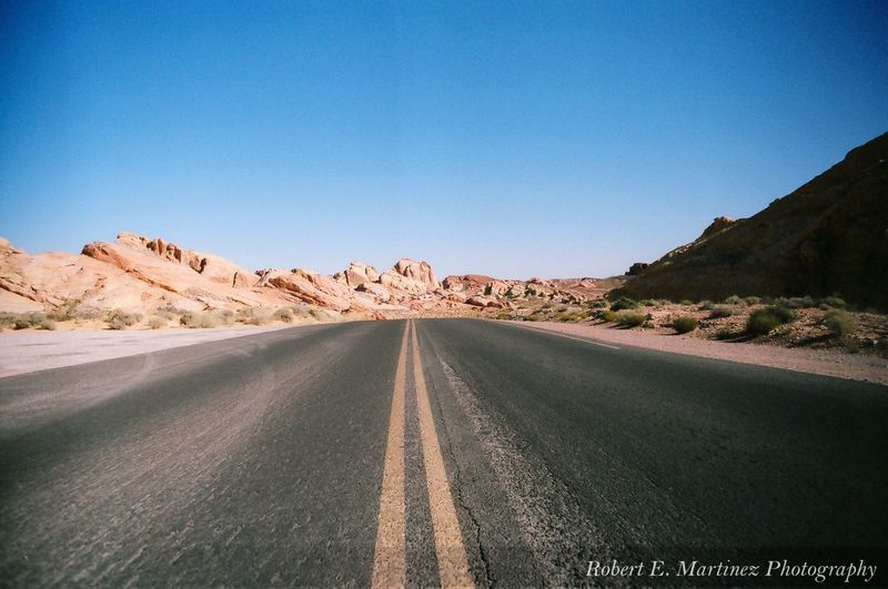 Road Clear Sky Transportation The Way Forward Rock - Object Day Blue No People Landscape Outdoors Sunlight Scenics Desert Nature Arid Climate Beauty In Nature Sky