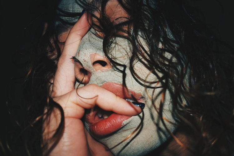 Close-Up Of Woman With Face Mask