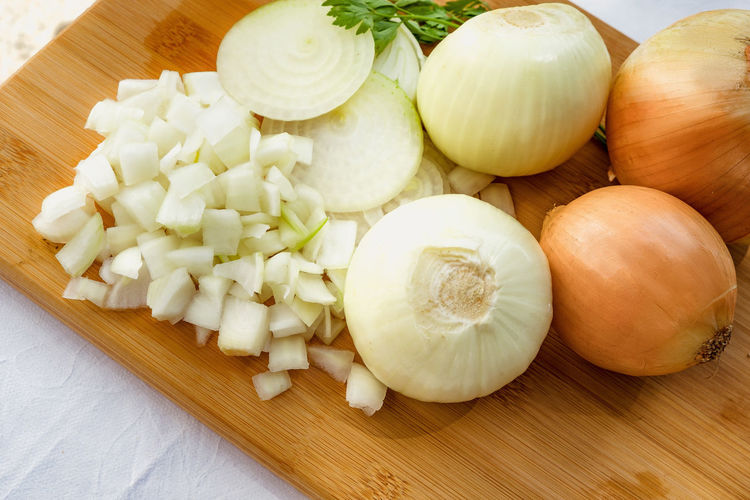 Onions with different types of cuts and portions Chopped Food Food And Drink Freshness Health Eating Healthy Eating Ingredient No People Onion Raw Food SLICE Still Life Table Vegetable Vegetarian Food Wood - Material