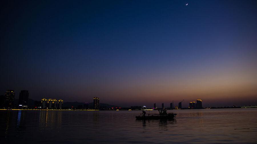 fishman Night Travel Destinations Reflection Sky River Water City Urban Skyline Lifestyles