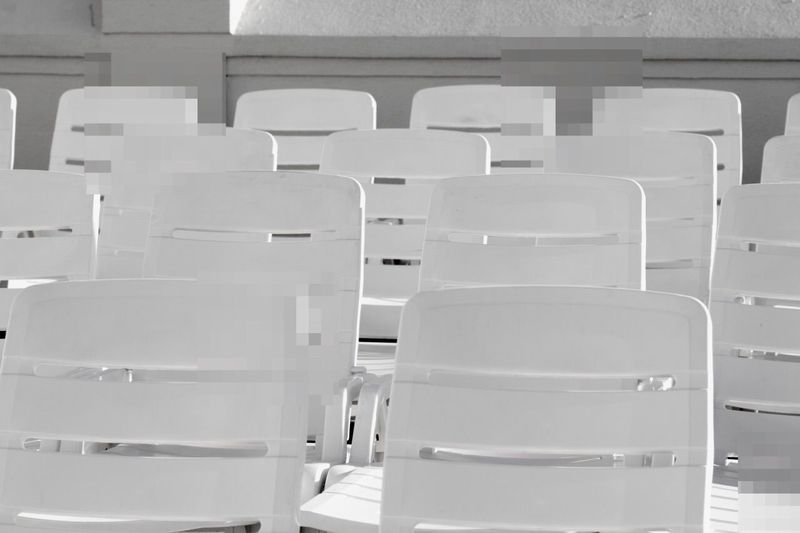 Empty chairs arranged in hall