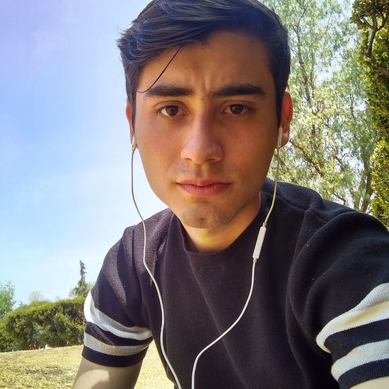 Music Spotify Young Adult Men Nature People Lifestyles Sky Earpods Teenager Portrait Sunlight One Person Headshot Only Men Adult Outdoors Human Body Part Adults Only Day Close-up One Man Only