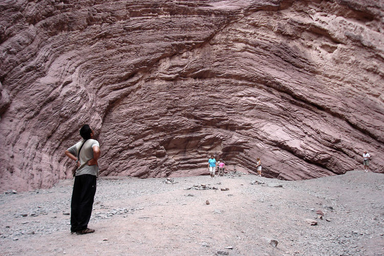 El Anfiteatro, Cafayate, Salta, Argentina. Cafayate, Salta, Argentina! Nature Adult Amphitheater Bonding Cafayate Day Full Length Land Leisure Activity Lifestyles Men Nature Outdoors People Real People Rear View Rock Rock - Object Rock Formation Solid Standing Togetherness Two People Women