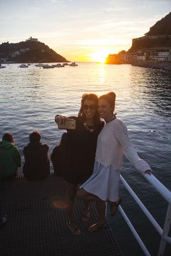 Mobile Conversations Selfıe Smiles Smiling Cellphone Friends Girls Sunset Sun Sea Light Sunshine Day San Sebastian Spaın Summer Saint Sebastian Guipuzkoa Guipuzcoa Donostia / San Sebastián Donosti  Donostia Pais Vasco Women Around The World Colour Your Horizn