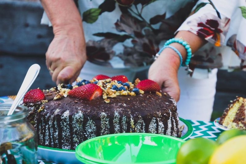 Slicing a birthday cake Sweet Food Indulgence Midsection Food And Drink Human Hand Temptation Unhealthy Eating Dessert Freshness Food Multi Colored One Person Celebration Real People Indoors  Ready-to-eat Close-up Human Body Part Birthday Cake Day Celebration Women Around The World