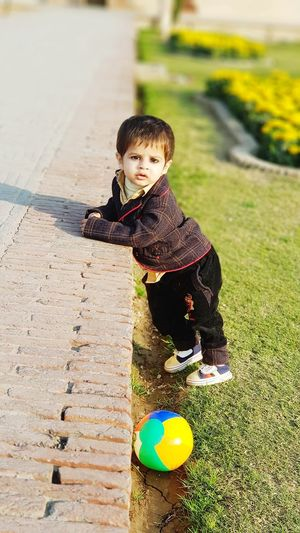 Cuteness overloaded...! 😍😍😍😗😗😗 Babyboy Boys Cutness Cutenessoverload Cute Childhood One Person Child Playing People Fun Children Only Cute Grass Happiness Sunlight Day