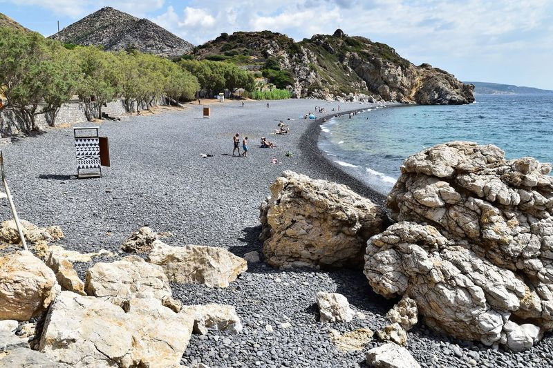 Beach Beachphotography Beauty In Nature Black Chios Day Greece Group Of People Holiday Incidental People Land Mavra Volia Mountain Nature Outdoors Real People Rock Rock - Object Rock Formation Scenics - Nature Sea Sky Solid Tranquility Water