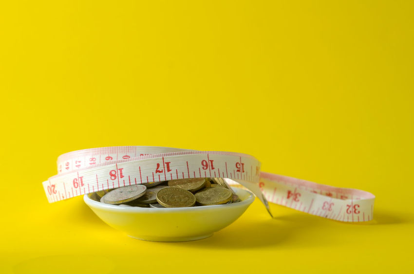 Close-up Colored Background Copy Space Cut Out Dieting Food Food And Drink Freshness Healthcare And Medicine Healthy Eating Indoors  Instrument Of Measurement No People Number Still Life Studio Shot Tape Measure Wellbeing Yellow Yellow Background