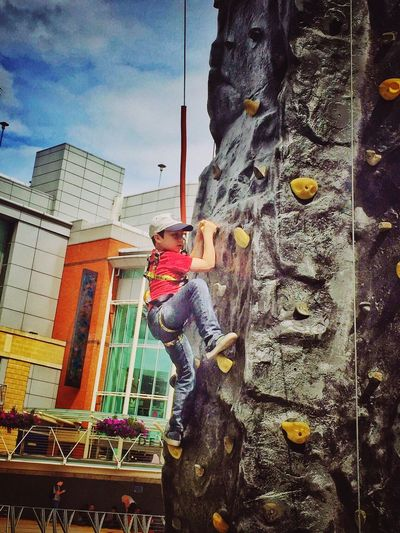 Child Boy Climbing Climbing Wall Outside Outdoors Adventure Leisure Activity Built Structure Childhood Adrenaline Climb Rope Helmet Safety Harness High Hight Exercise Cap Artificial Rock Climbing Tiring Frightening