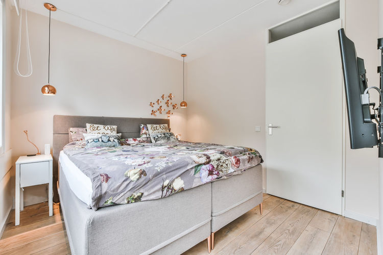 High angle view of empty bed at home