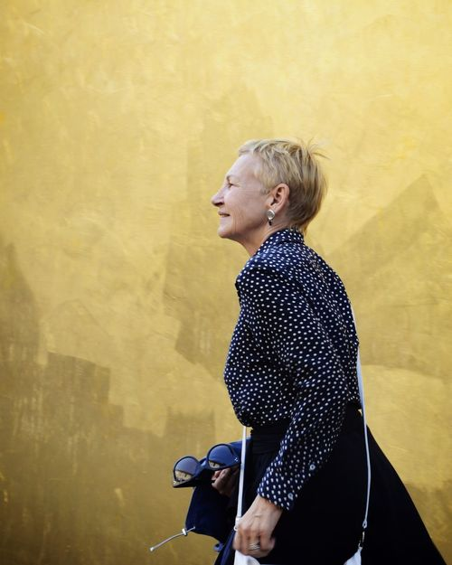 Woman Gold Colored Golden Portrait Streetphotography Streetportrait Monochrome Fondazione Prada Beauty Architecture_collection Art is Everywhere This Is Aging Blond Hair Standing Side View One Senior Woman Only Yellow Background Only Senior Women 70-79 Years Young At Heart