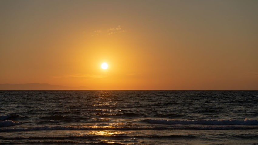 Beach Beauty In Nature Horizon Horizon Over Water Idyllic Land Nature No People Non-urban Scene Orange Color Outdoors Scenics - Nature Sea Sky Sun Sunset Tranquil Scene Tranquility Water Wave