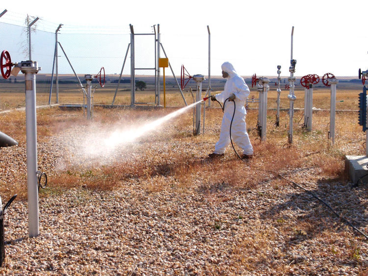 Fumigate Fumigating Fumigation  Gas Gas Mask Herbicide Man Man Working One Person Pest Pest Control Pipeline Plague Poison Poisonous Pulverize Real People Safety Security Spray Spraying Toxic Work Place Working Workplace Business Stories