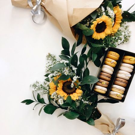 Sunflowers (Helianrhus) bouquet Flower Freshness Bouquet Leaf High Angle View No People Beauty In Nature Indoors  Flower Arrangement White Background First Eyeem Photo Fresh On Market 2017