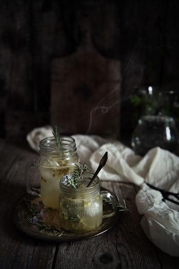 Close-Up Of Herbal Tea In Jar On Table