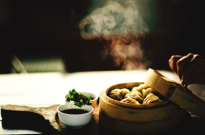 Close-up of dumplings in container on table