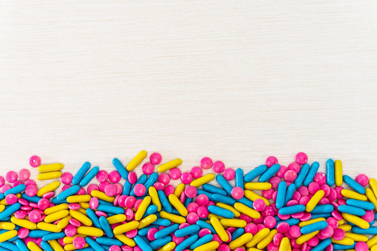 Directly above shot of colorful medicines on wooden table