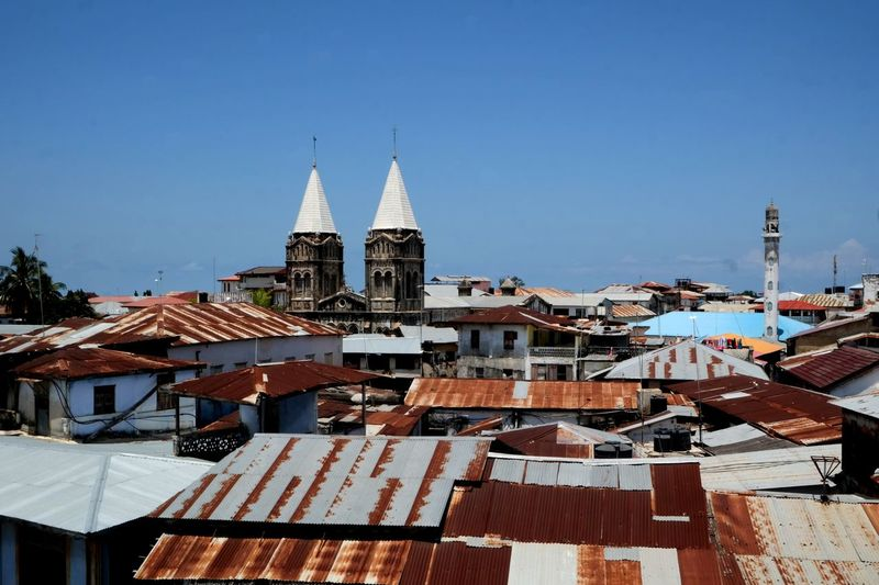 Architecture Building Exterior Built Structure Building Religion Place Of Worship Roof Sky Belief Spirituality Nature Clear Sky Copy Space High Angle View TOWNSCAPE Cityscape Spire  Deep Blue Sky Tanzania Africa Zanzibar Zanzibar_Tanzania Zanzibarisland Zanzibar Africa Stonetown Stonetownzanzibar Old Town Tropical Climate The Week on EyeEm EyeEm Best Shots EyeEm Selects EyeEm Gallery cityscapes Cityscape Rooftop From My Point Of View Church Architecture Church Buildings Over The Shoulder View Over The Top Sansibar