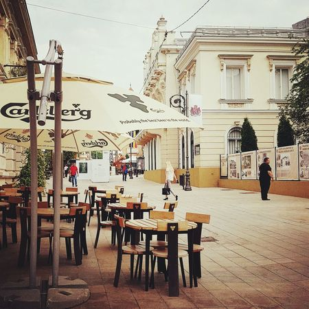 A walk in Iasi Chair Table History Architecture Cafe Day Full Length One Man Only Outdoors People Walk City Iasi A Walk To Remember Morning Walk
