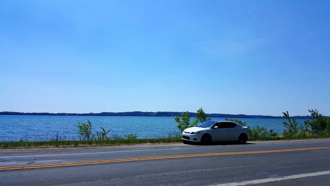 Scenic Drive Scenic Road Scion Tc Scion  Mein Automoment Water Road Road Trip Summer 45th Parallel Michigan Bay Freshwater Blue Sky Blue Water Daylight No People