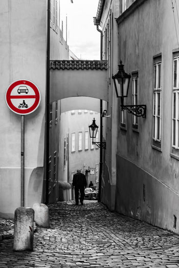 Daytime Prague Sightseeing Architecture Building Exterior Built Structure Full Length Keycolor Outdoors Rear View Road Sign Streetphotography Tourism Travel Destinations Walking