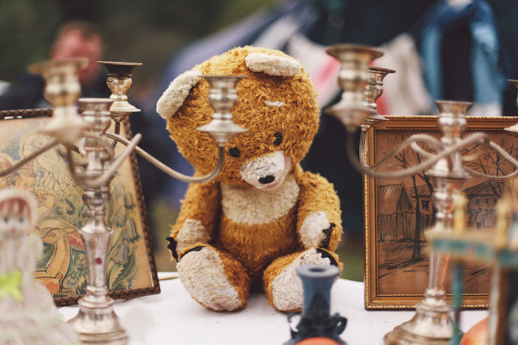 Teddy bear with decorations on table for sale in market