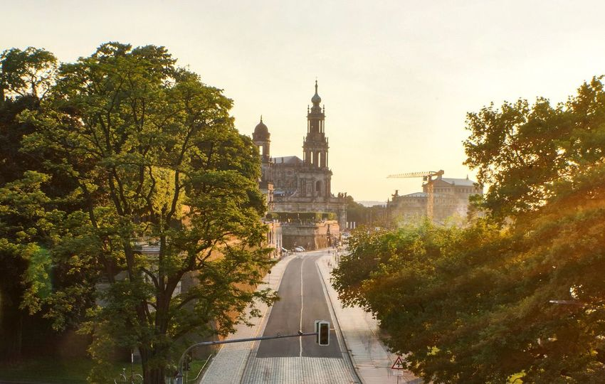 Dresden on Saturday evening with great sunlight and some fog Sightseeing Sunset Wanderlust Architecture Tree Plant Built Structure Building Exterior Sky Building Nature City Travel Destinations Growth Day Travel Green Color Outdoors No People Tourism Belief Religion Spire  The Traveler - 2018 EyeEm Awards Creative Space