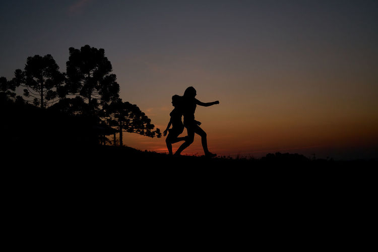 Beauty In Nature Day Full Length Landscape Lifestyles Nature One Person Outdoors People Real People Scenics Silhouette Sky Statue Sunset Tranquility Tree