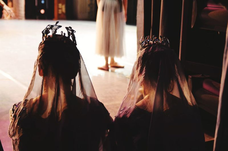 Rear view of women standing in traditional clothing