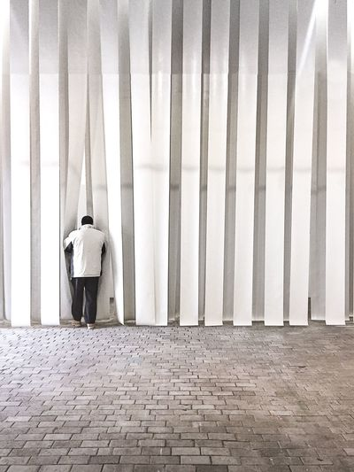 Curious Curiosity Mystery Curtain Getty Images Market Minimal Minimalism White Background White EyeEm Selects Rear View Full Length One Person Real People Men Built Structure Architecture Standing Lifestyles Casual Clothing Leisure Activity Adult