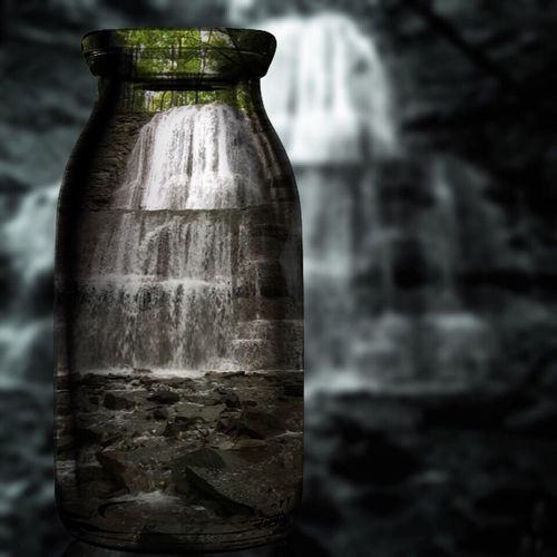 Sherman Falls in a bottle. Sherman Falls Focus On Foreground Close-up Fragility Tranquility No People Weathered