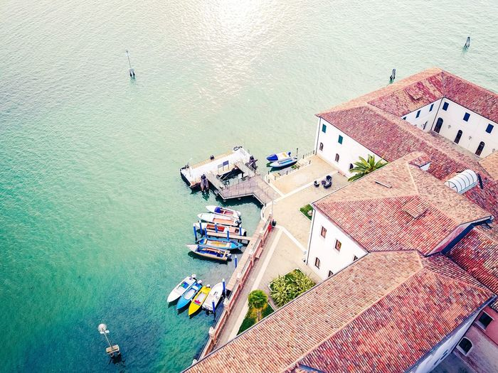 High Angle View Nautical Vessel Transportation Aerial View Day Building Exterior Water Outdoors Architecture No People Sea Built Structure Harbor City Cityscape Lagoon Venice, Italy Dronephotography Lost In The Landscape Connected By Travel Beauty In Nature Lagoon Of Venice Landscape Boats⛵️ Boats
