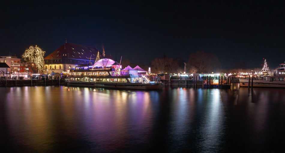 Weihnachstmarkt in Konstanz Water Night Illuminated Reflection Waterfront Architecture City Building Exterior Nature Travel Destinations Nautical Vessel Transportation Copy Space Outdoors Cityscape Konstanz Bodensee Weihnachten Weihnachtsmarkt Lake Constance Lake Constance Nightscape