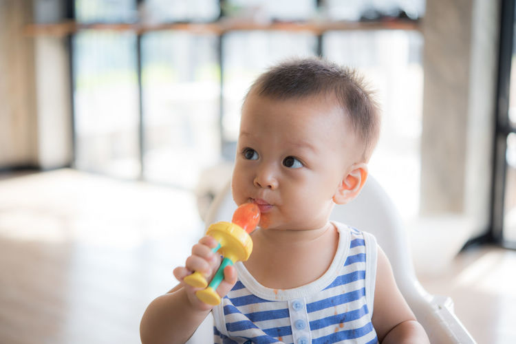 Innocence Childhood Cute Real People Child One Person Portrait Focus On Foreground Eating Front View Food And Drink Food Dairy Product Frozen Holding Headshot Looking At Camera Lifestyles Casual Clothing Outdoors Temptation