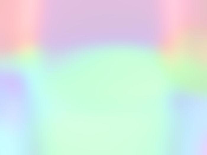 Defocused image of rainbow against blue background
