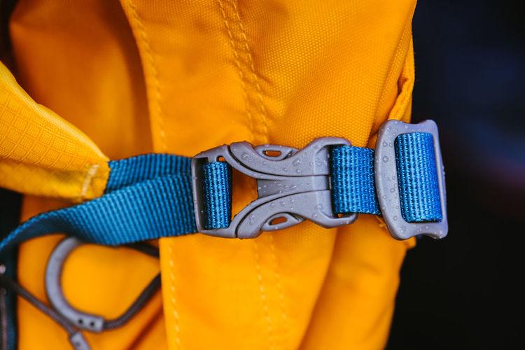 Close-up of a man holding yellow camera
