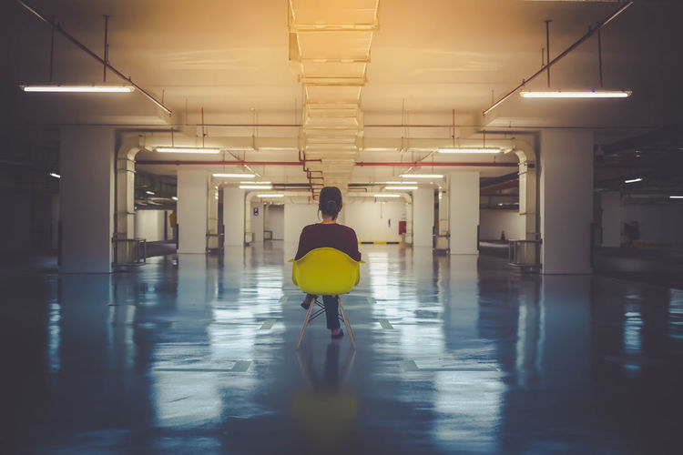 Items required for random fun - Yellow Chair - Empty Carpark - Camera Chair Empty Carpark Illuminated Indoors  One Person One Person Only Parking Garage People Real People Rear View Underground Car Park Woman Yellow Chair #urbanana: The Urban Playground International Women's Day 2019