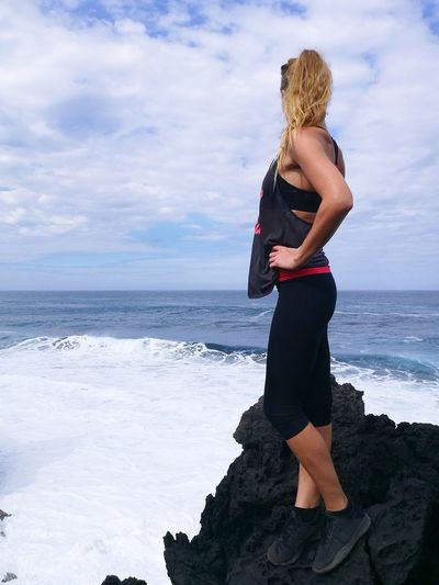 Morning fresh air Only Women Beach One Woman Only Sea Standing One Person Cloud - Sky Water Young Women Outdoors Sky Full Length Wave Blond Hair Travel Destinations EyeEm Selects Power In Nature