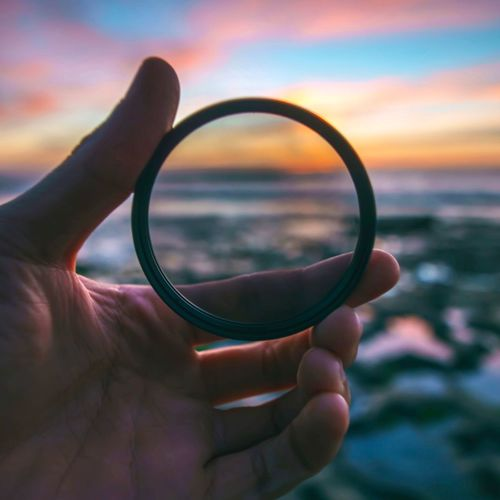 EyeEm Selects Human Hand Sky Human Finger Human Body Part Focus On Foreground One Person Close-up Sea Outdoors Holding Sunset Real People Cloud - Sky Beauty In Nature Nature Day Horizon Over Water People
