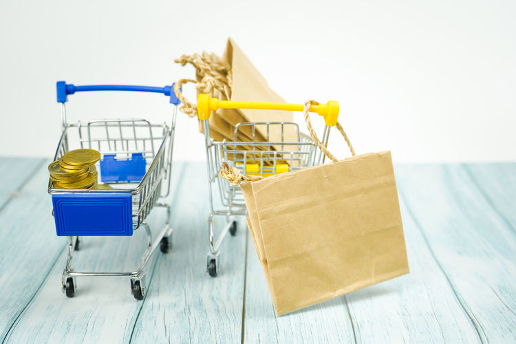 Close-up of shopping cart on table at store