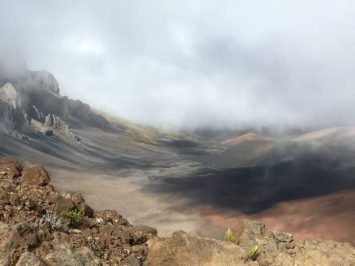 Volcanic Crater With Smoke Against Sky