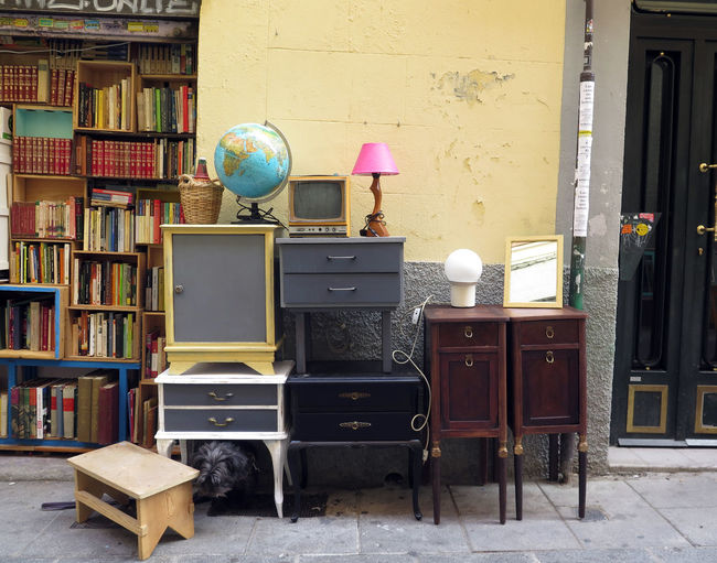Objects and furniture in a stall of el rastro market, madrid