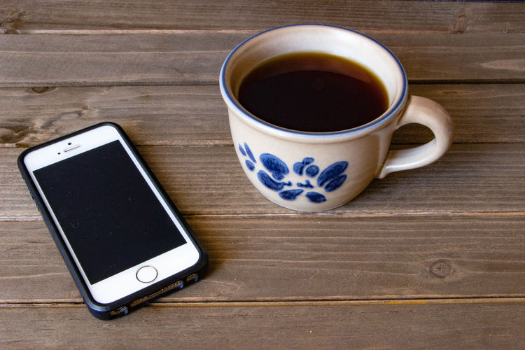 Coffee Communication Connection Cup Drink Food And Drink Mobile Phone Portable Information Device Refreshment Smart Phone Still Life Tea Cup Technology Wireless Technology Wood - Material