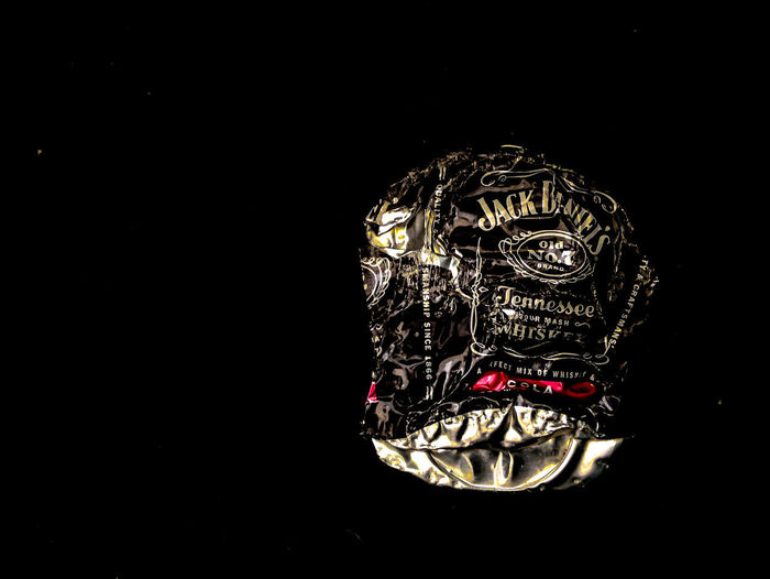 Jack Daniels Food And Drink Aluminium Can Art And Craft Black Background Close-up Copy Space Craft Creativity Cut Out Dark Design Gold Colored Indoors  Jackdaniels Metal No People Ornate Pattern Representation Sculpture Single Object Still Life Studio Shot